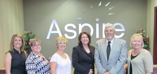 Toby Stark (center) stands with the Aspire staff. (Submitted photo)