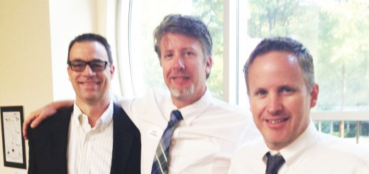 Left to right) United Real Estate president Peter Giese with Chris and Paul Scherrer. (Submitted photo)