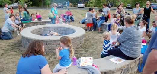 Parents and children gather around the Council Circle Fire Pit at Simon Moon Park eating s'mores before Vicki Parker's story telling last year.
