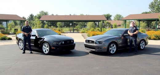 Police officers Mike Wheeler (left) and Eric Grimes will be behind the wheel of the two unmarked Mustangs. (Submitted photo)
