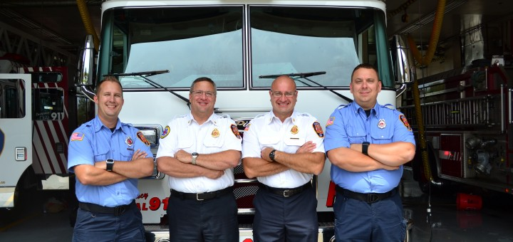 (From left) Fishers Fire and Emergency Services Lt. Josh Mehling, EMS Chief Steve Davison, Fire Chief Steve Orusa and Lt. Joe Harding at the main fire station, 2 Munici- pal Dr. Mehling, Davison and Harding are three of five Fishers Fire Dept. personnel involved in the new WeCare program.