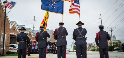 Members from the Carmel Fire and Police department Honor Guard stand in attendance during the memorial service.