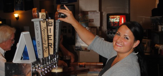 Rachel Cochran pours a pint of Westfield-produced beer at Grand Junction Brewing Co. The business, which started this spring, is the first recipient of the Spark Award since 2006. (Photo by Robert Herrington)