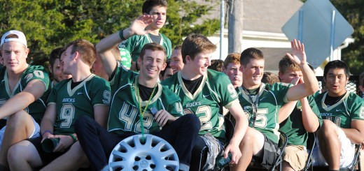 Members of the WHS football team receive cheers from the crowd prior to their Homecoming game.