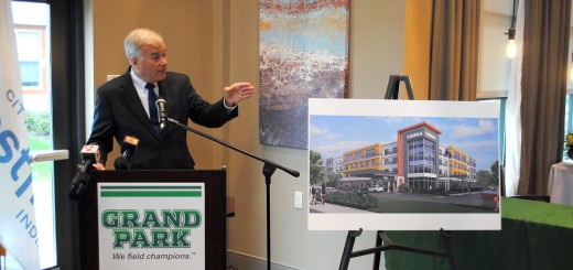 Mayor Andy Cook unveils the rendering of Cambria Suites, the first hotel at Grand Park Sports Campus, during an announcement on Oct. 15. The private investments fills a growing need for the city as Grand Parks guests have been using throughout Hamilton County, Indianapolis, Lebanon, Kokomo and Anderson. (Photo by Robert Herrington)