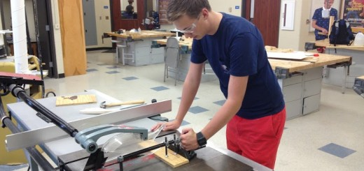 HSE senior Kendall Mason works with the table saw, building a practice game field for the robot. (Submitted photo)