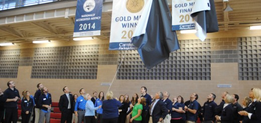 Park officials unveil new banner. (Photo by Mark Ambrogi)