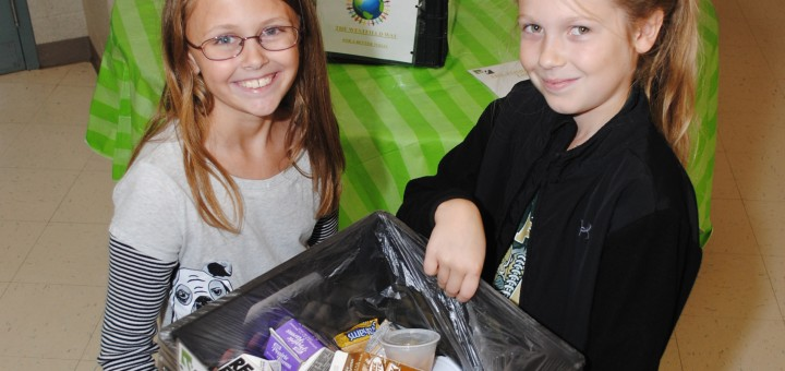 Caelyn Cramer, left, and Elizabeth Carney are among the Washington Woods Elementary School students that donate to the Westfield Food Rescue program. (Photo by Robert Herrington)