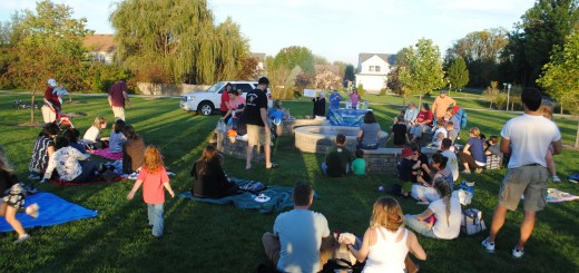After the craft, the crowd begins to surround the Simon Moon Park fire pit for s'mores and stories. (Photos by Robert Herrington)