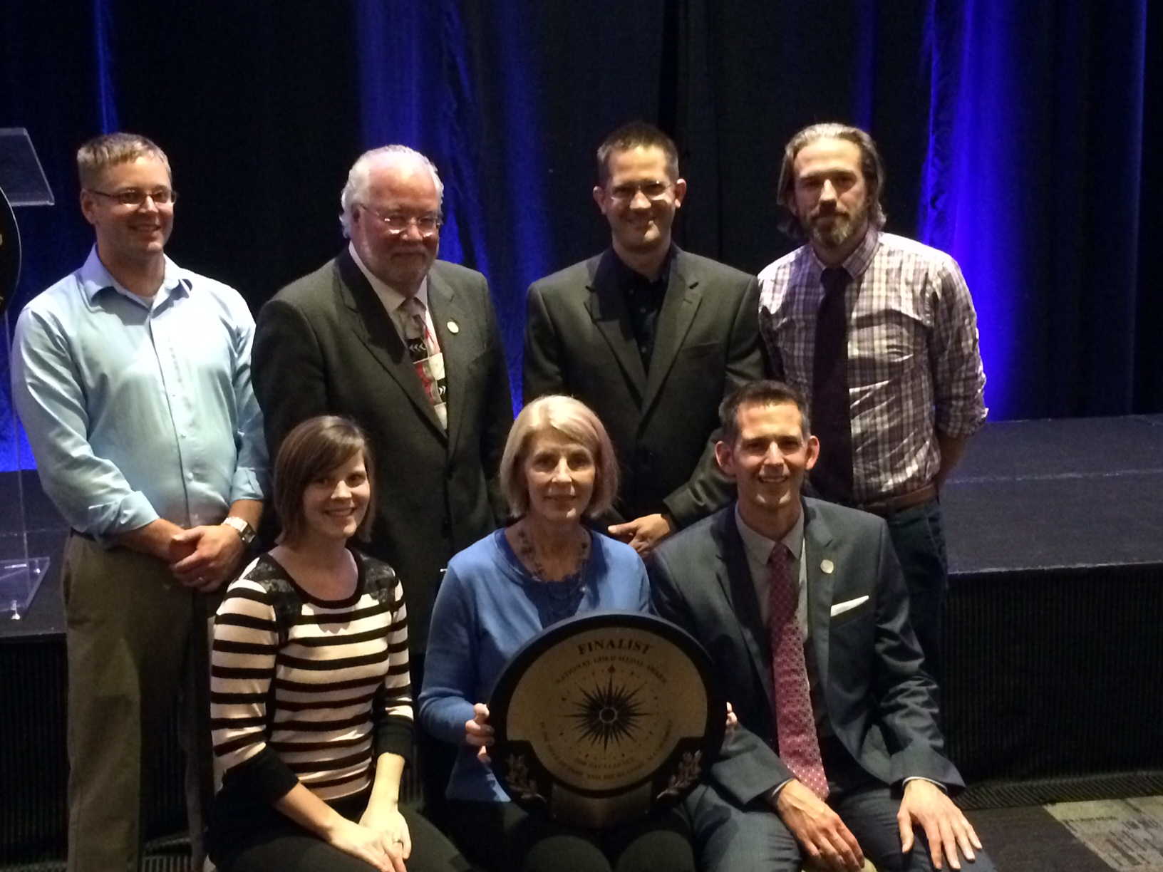 Senior staff members of the Carmel Clay Parks & Recreation department hold their gold medal. The group was in North Carolina this week to attend the 2014 National Recreation and Park Association Congress. Pictured here are (back row, left to right) Ben Johnson, Mark Westermeier, Kurtis Baumgartner, Eric Mehl, (front row, left to right) Lindsay Labas, Audrey Kostrzewa, and Michael Klitzing. (Submitted photo)