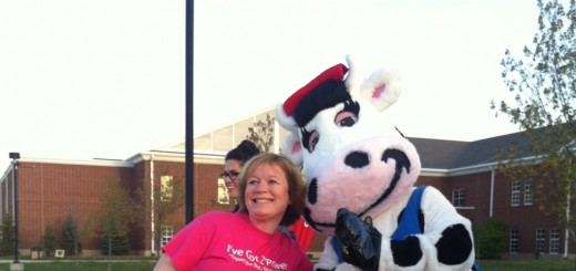 Former ZWMS principal Kris Deveraux smiles with the American Dairy Association mascot during last school year's Walk to School day. (Submitted photo)