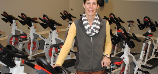 Lisa Herrmann, owner of Rally. Rock. Ride. shows the new cycling equipment in her studio. (Photo by Robert Herrington)