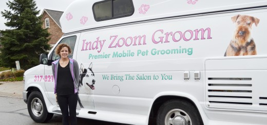 Haley Brown and her new mobile dog grooming van. Indy Zoom Groom focuses on the Fishers and Geist area. (Photo by Ann Craig-Cinnamon)