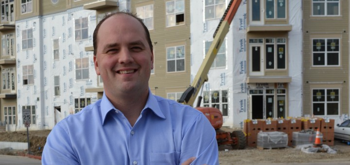 Fishers Town Manager and Mayor-elect Scott Fadness stands in front of the construction projects he has spearheaded in downtown Fishers. (Photo by John Cinnamon)