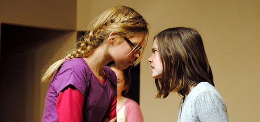 "Beth Bradley (Leah Kerkhoff), left, and Alice Wendlekin (Audrey Duprey) get in a heated argument about the Herdmans' behavior in ""The Best Christmas Pageant Ever."" (Photo by Robert Herrington)"