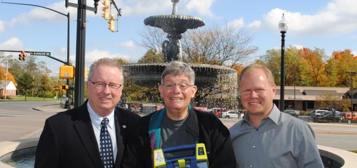 Indiana High School Athletic Association commissioner Bobby Cox, referee Joe Calderazzo (holding AED) and Carmel athletic director Jim Inskeep. (Photo by Mark Ambrogi)