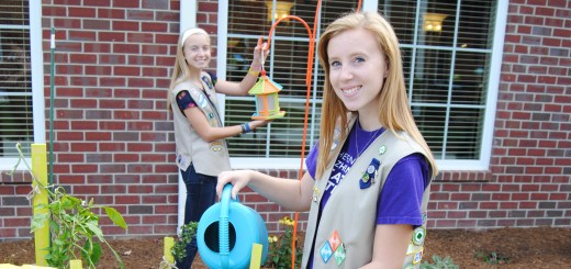Sisters Katy, left, and Sara Zaloudek completed their Girl Scout Silver and Gold awards respectively at Magnolia Springs at Bridgewater before the complex opened. (Photo by Robert Herrington)