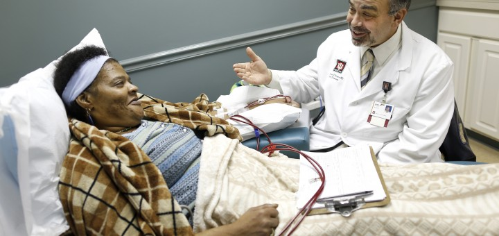 IU Health Nephrologist Dr. Michael Kraus talks to patient Regina Collins Steele during her dialysis session at his office. (Chris Bergin/ IU Health Visual Media)