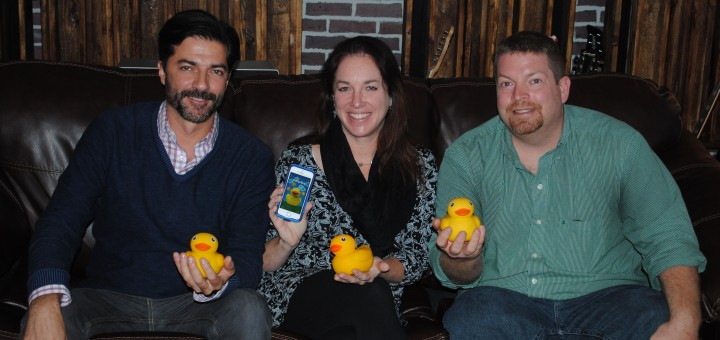 From left, Don Inman, Amy Unger and Matt MacBeth display Edwin the Duck. (Photo by Mark Ambrogi)