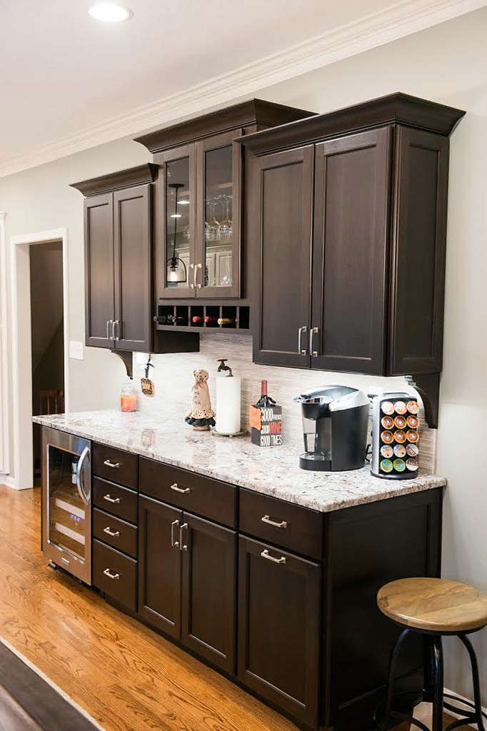 Column cabinet modifications warm colors transform a kitchen for Kitchen cabinets zionsville