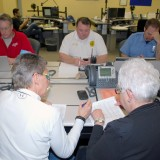 Officials work on power outage lists inside the Hamilton County Emergency Operations Center on Jan. 7. (File photo)