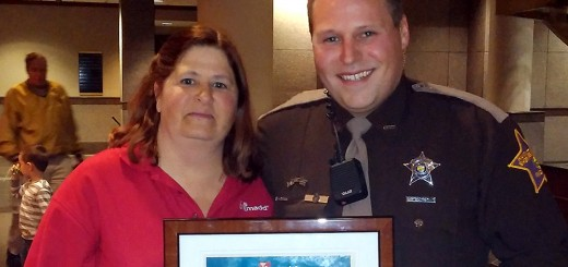 Pam Kelshaw, president of the local Mothers Against Drunk Drivers chapter, recognized Hamilton County Sheriff Deputy Kevin Crask for his efforts in getting drunken drivers off roadways. This year, Crask has made 96 arrests for operating while intoxicated. (Photo by Robert Herrington)