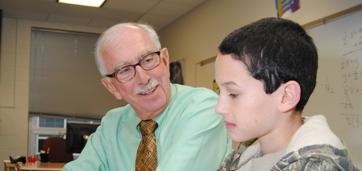Supt. Dr. Mark Keen works with fifth grader Johnathan Kendall at Westfield Intermediate School. Keen recently was named the 2015 Superintendant of the Year for District 5 by the Indiana Association of Public School Superintendents. (Photo by Robert Herrington)