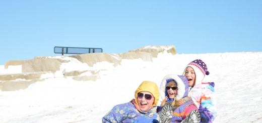 Kids sled down a hill. (Submitted photo courtesy of Carmel Clay Parks and Recreation)