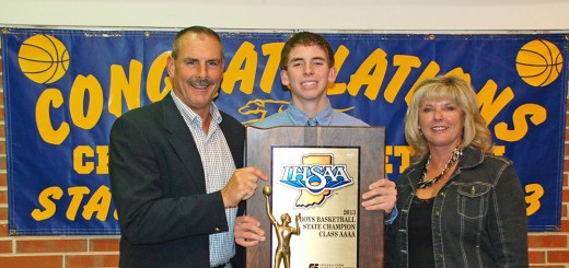 Ryan Cline with his parents after receiving an award last year.