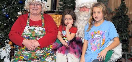 From left: Mrs. Claus, Breyanna Wagner, Santa Claus and Diamond Barrett pose for a picture before the girls talk about holiday gift ideas with Kris Kringle.
