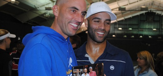 Carmel High School girls and boys tennis coach Mike Bostic gets his picture taken with James Blake holding a picture taken of the two of them when Bostic ran into Blake while attending the U.S. Open in New York. Blake earlier autographed the picture. (Photo by Mark Ambrogi)