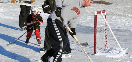 Brandon Wilson prepares to pass as teammates skate to the goal.
