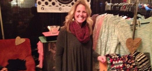 Amy Swinford of Retro101, the boutique on wheels, shows off her booth at the Indie Arts & Vintage Marketplace event last week. A booth might not be as exciting as a trunk show on a bus, but the apparel is just as appealing.