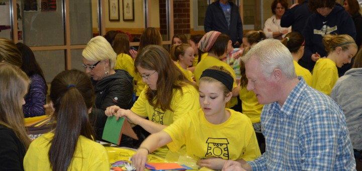 Kennedy Fisher shows Indy Diamonds players and parents how to assemble craft kits. (Photo by Beth Taylor)