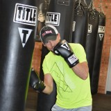 Chris Jordan, general manager of the Title Boxing Club in Fishers demonstrates boxing techniques. (Photo by Beth Taylor)