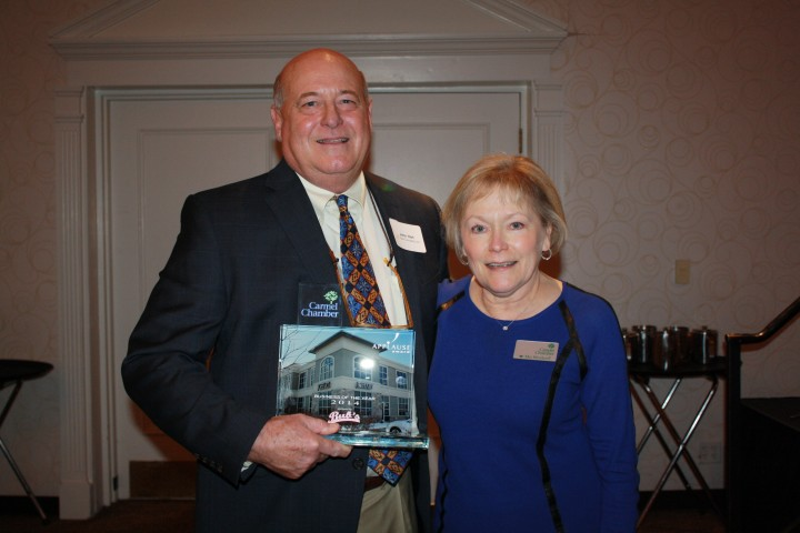 John Hart receiving the award Carmel Chamber of Commerce president Mo Merhoff. (Submitted photo)