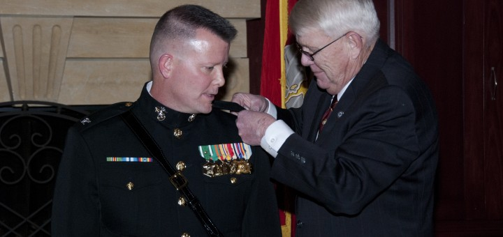 Scott Willis watches as his father, William Willis, a fellow Marine and Vietnam War veteran, pins his new colonel rank emblems on his shoulder on Jan. 17. (Submitted photo)