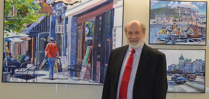 Tom Slakc shows 'Reflections' exhibit at Fishers City Hall. (Photo by Beth Taylor)