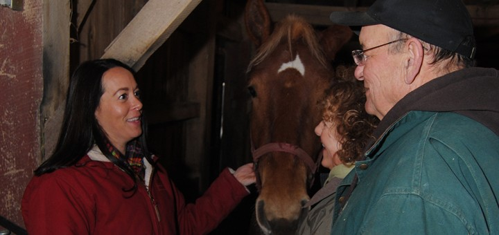 Washington Township Trustee Danielle Carey Tolan talks with her parents, Jim and Lynn Carey, on their family-farm, which has Belgium draft horses. (Photo by Robert Herrington)
