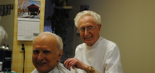Fred Baade cutting former Indianapolis Mayor William Hudnut's hair. (Photo by Mark Ambrogi)