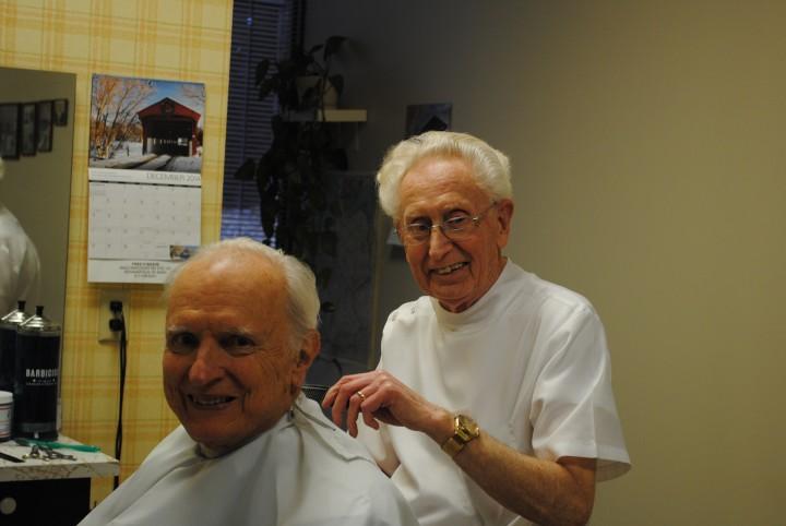 Fred Baade cutting former Indianapolis Mayor William Hudnut's hair. (Photo by Mark Ambrogi)