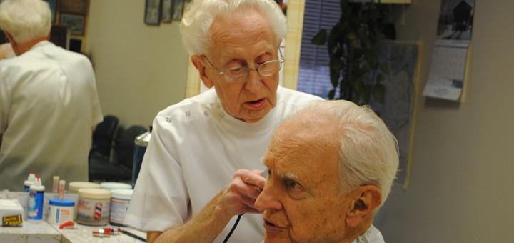 Fred Baade, a 48-year Carmel resident, cuts former Indianapolis Mayor William Hudnut's hair. (Photo by Mark Ambrogi)