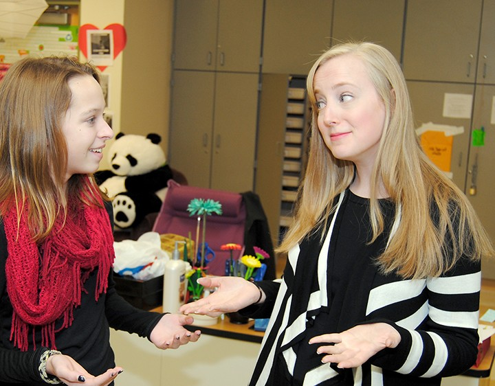 Westfield Middle School yearbook teacher Allie Staub, right, talks with eighth-grader Grace Bieghler, a staff member for this year's and the 2013-14 yearbook. (Photo by Robert Herrington)