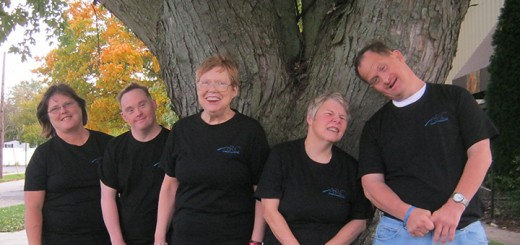 The Arc of Greater Boone County clients wear T-shirts sent to them by the group in Australia. (Submitted photo)