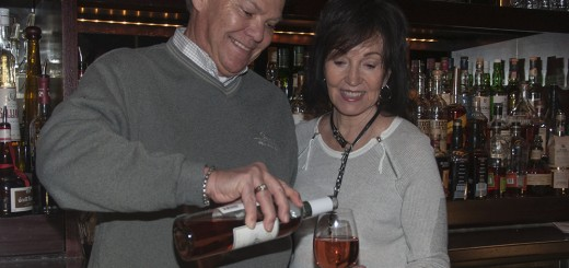 Joe Peterson pours his wife, Marilyn a glass of Peterson's Marilyn White Zinfan- del. (Photo by Heidi Schmidt)