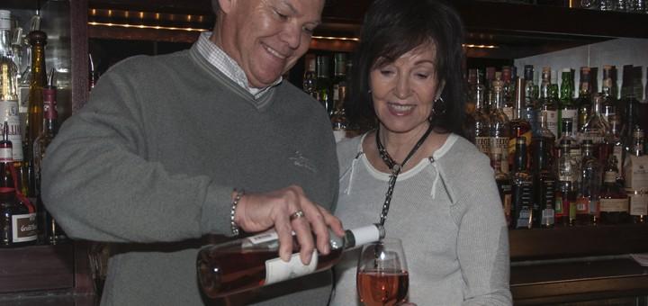 Joe Peterson pours his wife, Marilyn a glass of Peterson's Marilyn White Zinfan- del. (Photo by Heidi Schmidt)