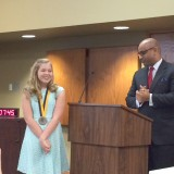 Sixth grader Olivia Keith receives Prudential Spirit of Community award from Reggie Jackson. (Photo by Beth Taylor)