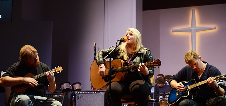 Lauren Baney performs at A Better Tommorrow: Hope for Human Trafficking concert, accompanied by Kyle Willman and Jonathan Baney.. (Photo by Theresa Skutt)