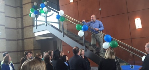 President and CEO David Becker with balloons to celebrate $1 billion in assets.