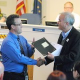 Westfield High School Band Director Mark Sands receives a handshake and the Music in Our Schools Month proclamation from Mayor Andy Cook. (Photos by Robert Herrington)